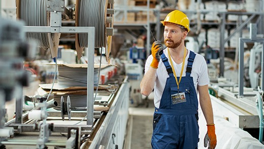 an employee in an industrial company wearing a badgy identification badge
